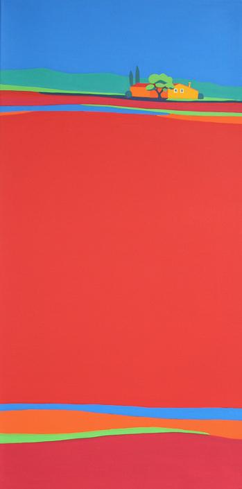 Rotes Mohnfeld mit Haus im Hintergrund
